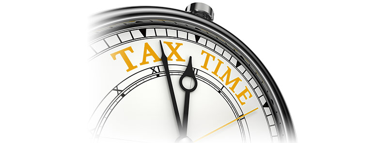 tax-time-concept-clock-closeup-isolated-white-background-red-black-words-31333588